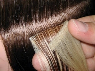 Single side tape hair extensions being attached