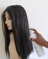 Spray moisturiser on hair extensions